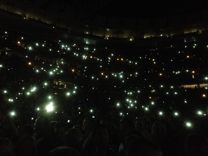 phones lit up in audience