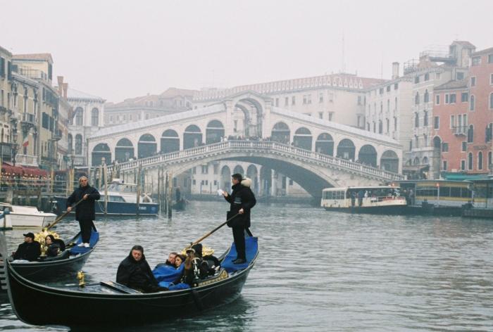 Venice Gondola - Gondolier reading paper