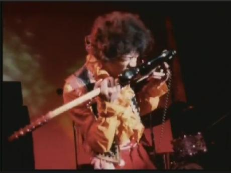 Jimi Hndrix teeth guitar playing
