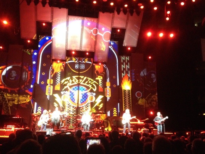 Eagles on stage with eagles logo