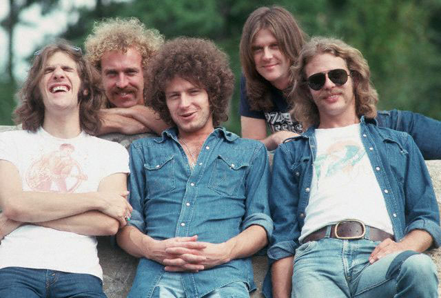 March 1972 --- The rock band The Eagles rest upon a rock.  The Eagles were the most popular band of the seventies and their reunion tour in the nineties was also very successful. --- Image by © Henry Diltz/CORBIS