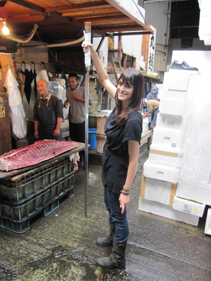 tokyo fish market morgan webb big sword pose