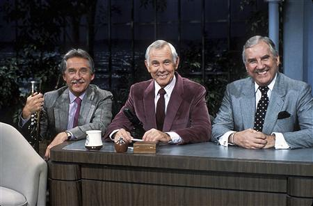 """The Tonight Show with Johnny Carson"" host Johnny Carson (C) poses with band leader Doc Severinsen (L)and sidekick Ed McMahon, in an undated photo. REUTERS/NBC/Handout"