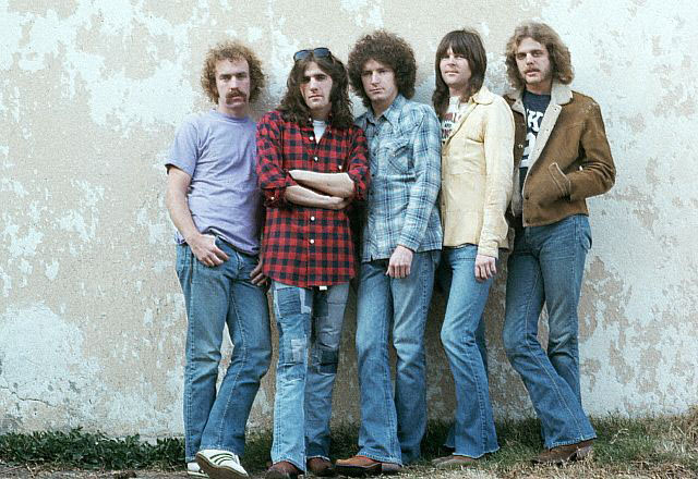 February 1974 --- The members of The Eagles stand against a wall.  The Eagles were the most popular band of the seventies and their reunion tour in the nineties was also very successful. --- Image by © Henry Diltz/CORBIS