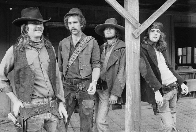 20 Dec 1972, USA --- Members of the rock band The Eagles are dressed up in cowboy costumes for their  album photo shoot. From left to right: Don Henley, Bernie Leadon, Randy Meisner, and Glenn Frey. --- Image by © Henry Diltz/CORBIS