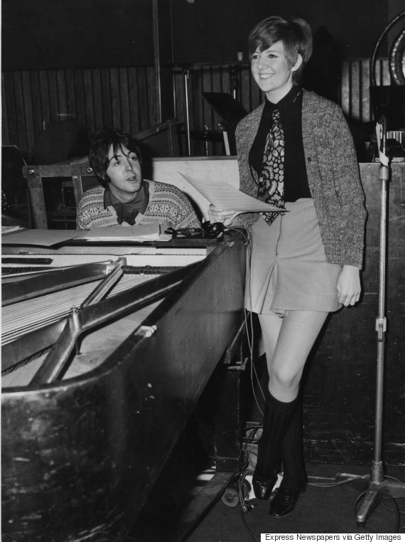 Pop singer and entertainer Cilla Black (Priscilla White) rehearses a song with Paul McCartney in a recording studio; the Beatle has written the song 'Step Inside Love', which will be the theme song for Cilla's new television show.  Original Publication: People Disc - HB0137   (Photo by Express Newspapers/Getty Images)