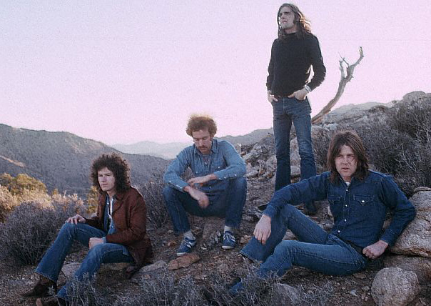 March 1972 --- The rock band The Eagles rest in a desert valley.  The Eagles were the most popular band of the seventies and their reunion tour in the nineties was also very successful. --- Image by © Henry Diltz/CORBIS