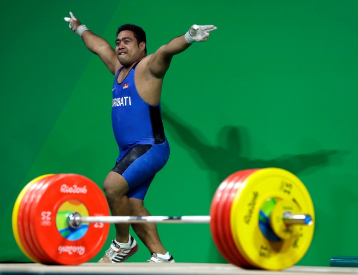 David Katoatau, of Kiribati, dances off the platform after an unsuccessful attempt on his final lift in the men's 105 kg weightlifting event at the 2016 Summer Olympics in Rio de Janeiro, Brazil, Monday, Aug. 15, 2016. (AP Photo/Mike Groll)