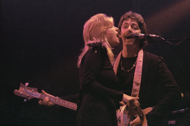 Former Beatle Paul McCartney and wife Linda on the opening night of his three sold-out concerts at London's Empire Pool, Wembley on October 19, 1976. (AP Photo/John Glanville)