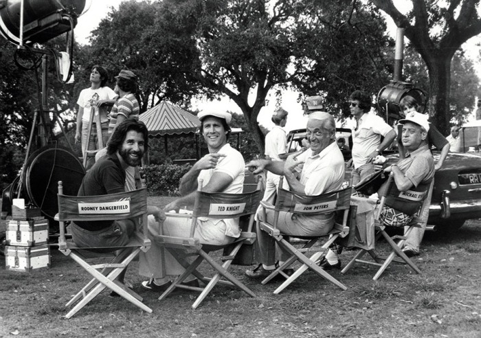 CADDYSHACK, from left: Executive Producer Jon Peters, Chevy Chase, Ted Knight, Rodney Dangerfield, 1980. © Orion Pictures/ Courtesy: Everett Collection