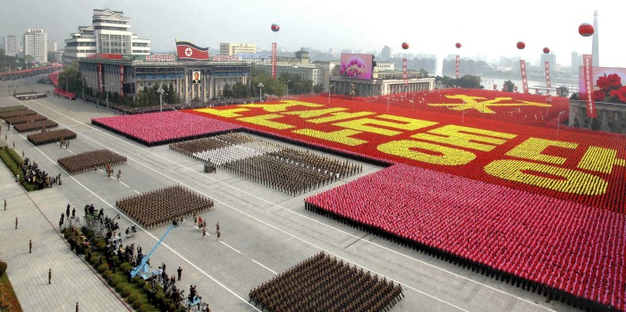 "A view of a parade to commemorate the 65th anniversary of the founding of the Workers' Party of Korea in Pyongyang in this October 10, 2010 file photo.  North Korean leader Kim Jong-il died on a train trip, state television reported on December 19, 2011 sparking immediate concern over who is in control of the reclusive state and its nuclear programme. A tearful announcer dressed in black said the 69-year old had died on December 17, 2011 of physical and mental over-work on his way to give ""field guidance"".    REUTERS/KCNA/Files (NORTH KOREA - Tags: POLITICS MILITARY ANNIVERSARY OBITUARY) NO THIRD PARTY SALES. NOT FOR USE BY REUTERS THIRD PARTY DISTRIBUTORS"